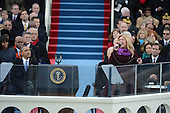 President Barack Obama watches Kelly Clarkson sing after being sworn-in for a second term as the President of the United States by Supreme Court Chief Justice John Roberts during his public inauguration ceremony at the U.S. Capitol Building in Washington, D.C. on January 21, 2013.     .Credit: Pat Benic / Pool via CNP