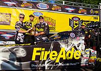 May 6, 2018; Commerce, GA, USA; NHRA top fuel driver Leah Pritchett (center) celebrates with sponsor Ron Thames after winning the Southern Nationals at Atlanta Dragway. Mandatory Credit: Mark J. Rebilas-USA TODAY Sports
