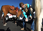 U.S. Sen. Dean Heller, R-Nev., cleans out the shoes on his wife Lynne's horse before the Nevada Day parade in Carson City, Nev. on Saturday, Oct. 27, 2012. .Photo by Cathleen Allison