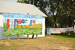 Life on the Hi-Line mural: Art imitates life with cloths line painting and real cloths line with clothing, Hinsdale, Mont.