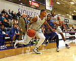 SIOUX FALLS, SD - NOVEMBER 24: Charles Ward #22 from the University of Sioux Falls drives past Bryant Allen #3 from Dakota State University in the first half of their game Monday night at the Stewart Center.  (Photo by Dave Eggen/Inertia)