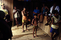 Relationship between Yanomami indigenous people and independent mine workers called garimpeiros who invaded the indigenous territory. Warehouse in mining area, Paapiu region, Roraima State, Amazon rainforest, Brazil.