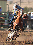 Nick Uhart competes in the calf-roping event at the Minden Ranch Rodeo action Saturday, July 21, 2012..Photo by Cathleen Allison
