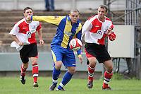 Toran Senghore of Romford evades Gavin Bamford - Romford vs Beaconsfield SYCOB - FA Cup Preliminary Round Football at Mill Field, Aveley FC - 29/08/10 - MANDATORY CREDIT: Gavin Ellis/TGSPHOTO - SELF-BILLING APPLIES WHERE APPROPRIATE. NO UNPAID USE. TEL: 0845 094 6026