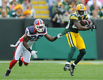Green Bay Packers' Donald Driver makes a first quarter first down catch ahead of Buffalo Bills' Drayton Florence during the home opener at Lambeau Field in Green Bay, Wis., on Sunday, Sept. 19, 2010.