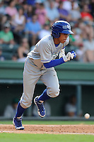 Shortstop Raul Adalberto Mondesi (2) of the Lexington Legends bats in a game against the Greenville Drive on Sunday, July 21, 2013, at Fluor Field at the West End in Greenville, South Carolina. Mondesi is the No. 5 prospect of the Kansas City Royals. Lexington won, 2-0. (Tom Priddy/Four Seam Images)