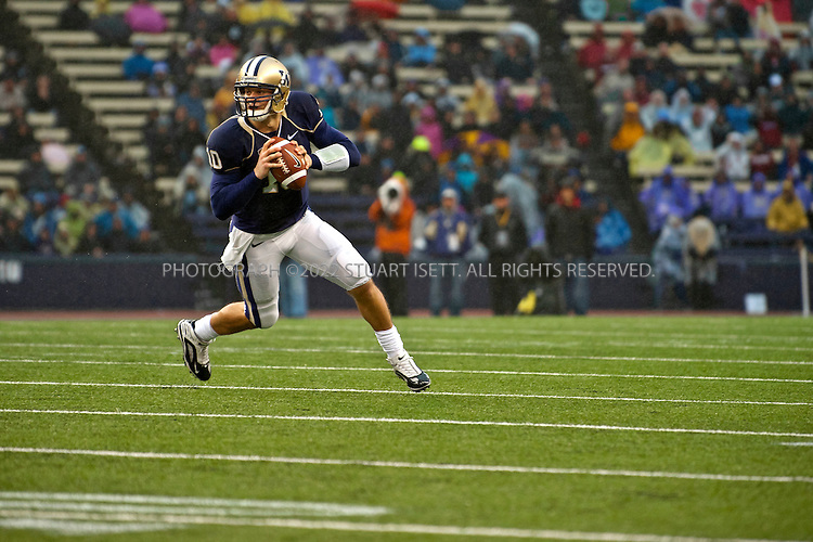 10/30-2010--Seattle, WA, USA..Jake (Jacob) Locker, 22, is the quarterback for the University of Washington Huskies football team. He is the starting quarterback at the on the teak and a top NFL draft prospect when he graduates in 2011. Originally from Ferndale, WASH., Scott Locker, Jake's father and friends and family from Ferndale have been regular tailgaters at all his games in a group called the 'Ferndawgs'...Here Jake Locker (#10) is playing quarterback in the Oct. 30th game against Stanford which the Huskies lost, 41-0 at home. ..©2010 Stuart Isett. All rights reserved.