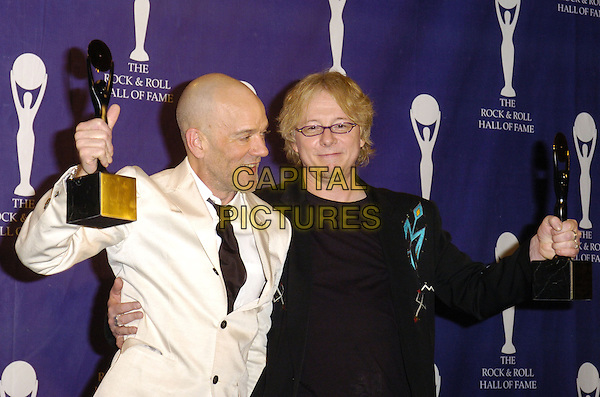 MICHAEL STIPE & MIKE MILLS - R.E.M..The 22nd annual Rock And Roll Hall Of Fame  induction ceremony at the Waldorf Astoria Hotel, New York, New York, USA..March 12th, 2007.half length rem white suit jacket award trophy black .CAP/ADM/BL.©Bill Lyons/AdMedia/Capital Pictures *** Local Caption ***
