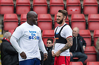 Adebayo Akinfenwa of Wycombe Wanderers chats to former Wimbledon teammate Callum Kennedy of Leyton Orient ahead of the Sky Bet League 2 match between Leyton Orient and Wycombe Wanderers at the Matchroom Stadium, London, England on 1 April 2017. Photo by Andy Rowland.