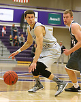 SIOUX FALLS, SD - DECEMBER 8:  Mack Johnson #3 from the University of Sioux Falls looks to make a move against Turner Moen #21 from Southwest Minnesota State Tuesday night at the Stewart Center. (Photo by Dave Eggen/Inertia)