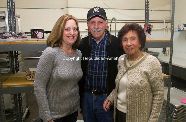 WATERBURY, CT.- 08 MARCH 2015 - 030815JW13 - Lynn D'Aneillo, Robert D'Aniello, and Dolly Mastronunzio pose for a photo during Sweet Maria's bakery's 25th anniversary celebration Sunday afternoon.<br /> Jonathan Wilcox Republican-American