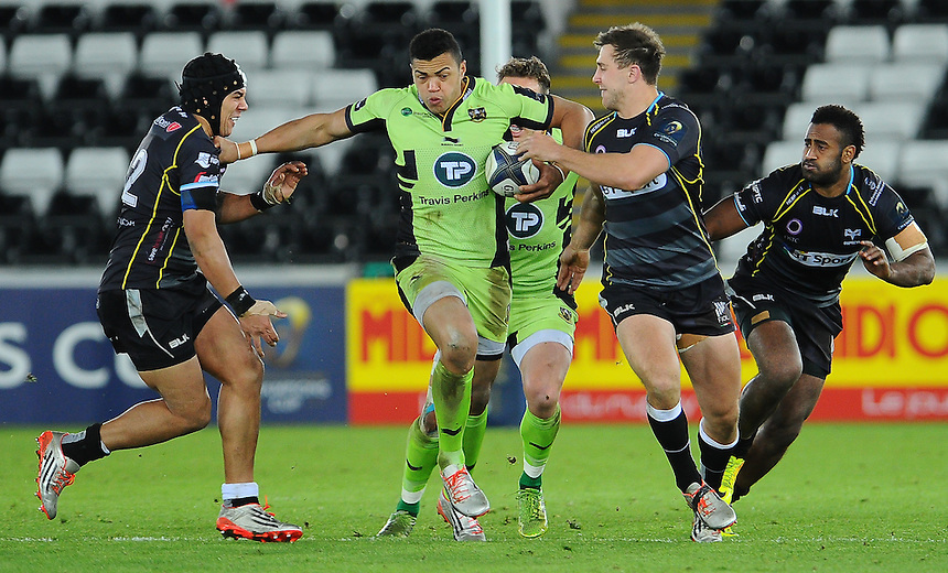 Northampton Saints Luther Burrell is tackled by Ospreys Josh Matavesi and Ashley Beck<br /> <br /> Photographer Craig Thomas/CameraSport<br /> <br /> Rugby Union - European Rugby Champions Cup - Pool 5 - Ospreys v Northampton Saints - Sunday 18th January 2015 - Liberty Stadium - Swansea<br /> <br /> &copy; CameraSport - 43 Linden Ave. Countesthorpe. Leicester. England. LE8 5PG - Tel: +44 (0) 116 277 4147 - admin@camerasport.com - www.camerasport.com