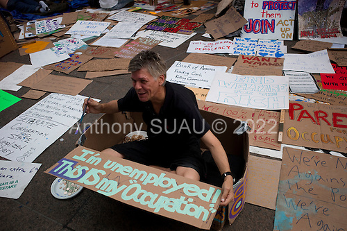 New York, New York<br /> October 10, 2011<br /> <br /> &quot;Occupy Wall Street&quot; protesters encampment at Zuccotti Park overflows on to adjacent streets as many  people come to take part or view the site.<br /> <br /> The participants of the event, that began on September 17, are mainly protesting against social and economic inequality, corporate greed, and the influence of corporate money and lobbyists on government, among other concerns.