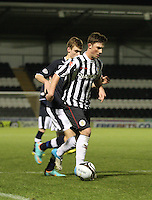Jordan Kirkpatrick being pursued by Connor McLeod in the St Mirren v Dundee Clydesdale Bank Scottish Premier League Under 20 match played at St Mirren Park, Paisley on 14.1.13.