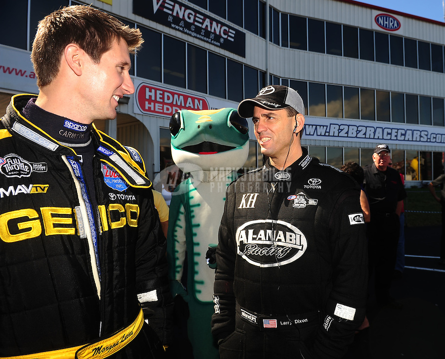 May 15, 2011; Commerce, GA, USA: NHRA top fuel dragster driver Morgan Lucas (left) talks with Larry Dixon during the Southern Nationals at Atlanta Dragway. Mandatory Credit: Mark J. Rebilas-