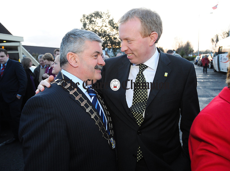 Mayor of Clare Tony Mulcahy of Fine Gael chatting with Fianna Fail TD Timmy Dooley on the arrival of new Minister for Defence Tony Killeen back to the home county last Friday night. Photograph by John Kelly.