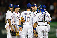 Texas Rangers (L to R) Elvis Andrus, Ian Kinsler, Michael Young, Mike Napoli, and Yorvit Torrealba wait during a pitching change at the Major League Baseball game against the Texas Rangers at the Rangers Ballpark in Arlington, Texas on July 27, 2011. Minnesota defeated Texas 7-2.  (Andrew Woolley/Four Seam Images)