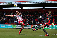 Anssi Jaakkola of Reading clears from Danny Newton of Stevenage during Stevenage vs Reading, Emirates FA Cup Football at the Lamex Stadium on 6th January 2018