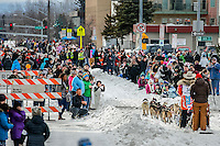Spectators line Cordova Street as Kim Franklin passes during the Ceremonial Start of the 2016 Iditarod in Anchorage, Alaska.  March 05, 2016