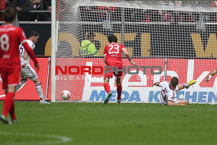 11.05.2013, Esprit Arena, Duesseldorf, GER, 1. FBL, Fortuna Duesseldorf vs 1. FC N&uuml;rnberg, im Bild<br /> Tor zum 1:0 f&uuml;r D&uuml;sseldorf. Hanno Balitsch (Nuerberg #5) (li.) f&auml;lscht eine Flanke von Andreas Lambertz (Duesseldorf #17) ins eigene Tor ab. Robbie Kruse (Duesseldorf #23) (re.) schaut zu<br /> <br /> Foto &copy; nph / Mueller