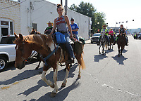 A horseback rider participates in the Harrison Roundup Club's wagon train Friday, June 19, 2020, through downtown Harrison. Nine wagons and 49 horses left the Northwest Arkansas District Fairgrounds in Harrison and traveled through downtown before heading out on a five-day and five night trip to Blue Springs located just east of Springdale. The annual wagon train, a tradition since 1977 normally would arrive to participate in the Rodeo of the Ozarks parade in Springdale but because of the covid-19 pandemic, the rodeo has been postponed. Visit nwaonline.com/200620Daily/ and nwadg.com/photos for a photo gallery.<br /> (NWA Democrat-Gazette/David Gottschalk)