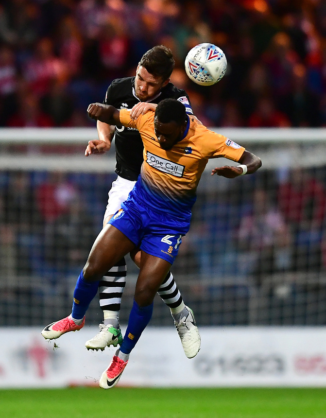 Lincoln City's Luke Waterfall vies for possession with Mansfield Town's Omari Sterling-James<br /> <br /> Photographer Chris Vaughan/CameraSport<br /> <br /> The EFL Checkatrade Trophy - Mansfield Town v Lincoln City - Tuesday 29th August 2017 - Field Mill - Mansfield<br />  <br /> World Copyright &copy; 2018 CameraSport. All rights reserved. 43 Linden Ave. Countesthorpe. Leicester. England. LE8 5PG - Tel: +44 (0) 116 277 4147 - admin@camerasport.com - www.camerasport.com