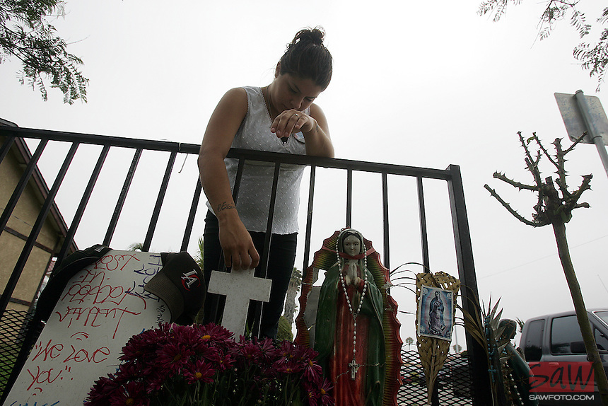 Christina Bojorquez, (cq)18, girlfriend of murdered teenager Vincent Martinez at site in front of her home where her boyfriend was shot dead. Bojorquez is pregnant with Vincent's child. Grieving Oxnard mother Marisa Martinez is offers a reward to find the killers of her 19-year-old son,Vincent. Vincent would have turned 20 later this month. He was gunned down four months ago in front of his home, leaving behind a broken family and pregnant girlfriend. Unwilling to let this fade into just another Oxnard murder, Marisa Martinez has collected a reward and won't rest til she finds Vincent's killer.