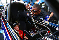 May 31, 2013; Englishtown, NJ, USA: NHRA top fuel dragster driver Antron Brown (right) lets a young boy sit in the cockpit of his car during qualifying for the Summer Nationals at Raceway Park. Mandatory Credit: Mark J. Rebilas-