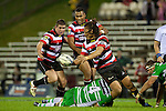 Tana Umaga looks to pass to Grant Henson. ITM Cup rugby game between Counties Manukau and Manawatu played at Bayer Growers Stadium on Saturday August 21st 2010..Counties Manukau won 35 - 14 after leading 14 - 7 at halftime.