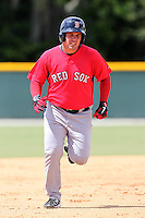 Boston Red Sox outfielder Juan Carlos Linares #38 rounds the bases during an Instructional League game against the Baltimore Orioles at Buck O'Neil Complex in Sarasota, Florida;  October 6, 2011.  (Mike Janes/Four Seam Images)