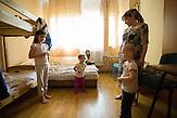 Islam Baskhanov. Aiset Garsieva. (children: Raiana Baskhanova, Aidina Baskhanova, Chadiża Baskhanova, Aisza Baskhanova) Refugee Center Grotniki. 2015.07.30. Grotniki, near Łódź. Poland