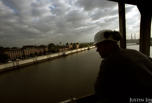 A construction worker atop Hamburg's Wilhemsburg area, across the Elbe river from the centre. ..Wilhemsburg is one of the most ethnically diverse quarters in Hamburg, with Africans, former Yugloslavians and Turks as the largest groups. ..