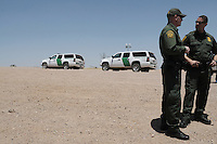 Tucson, Arizona - U.S. Customs Border Protection (CBP) Public Affairs officers Jeremy Copeland  (left) and Brent Cagen (right) talk to members of the national and international media. They transported reporters to the U.S.-Mexico border during a two-day event organized by the Tucson Sector Border Patrol. The event brought national and international journalists to the Arizona border to become acquainted with the dynamics of this area. Photo by Eduardo Barraza © 2012