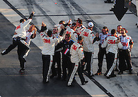Sept. 21, 2008; Dover, DE, USA; Crew members for Nascar Sprint Cup Series driver Greg Biffle (not pictured) celebrate after winning the Camping World RV 400 at Dover International Speedway. Mandatory Credit: Mark J. Rebilas-