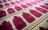 Rug on the floor in the interior of the Masjid Al-Aman mosque serving the Bangladeshi community in the City Line neighborhood of Brooklyn in New York on Wednesday, November 2, 2016.  The small neighborhood has become an enclave for Bangladeshi immigrants. (© Richard B. Levine)