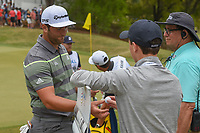 Jon Rahm (ESP) hands autographed golf balls to the sign bearers following his match during day 3 of the WGC Dell Match Play, at the Austin Country Club, Austin, Texas, USA. 3/29/2019.<br /> Picture: Golffile | Ken Murray<br /> <br /> <br /> All photo usage must carry mandatory copyright credit (© Golffile | Ken Murray)