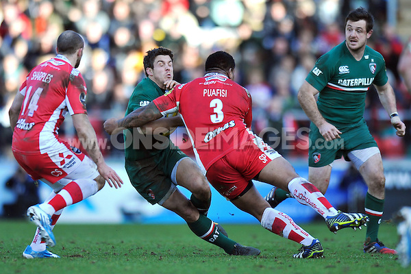 Anthony Allen is tackled by Sila Puafisi. Aviva Premiership match, between Leicester Tigers and Gloucester Rugby on February 16, 2014 at Welford Road in Leicester, England. Photo by: Patrick Khachfe / JMP