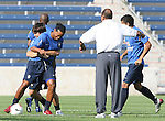 08 September 2007: Ronaldinho (left) is held by Kleber as assistant coach Carlos Alberto Torres (in white) watches. The Brazil Men's National Team practiced at Toyota Park in Bridgeview, Illinois.