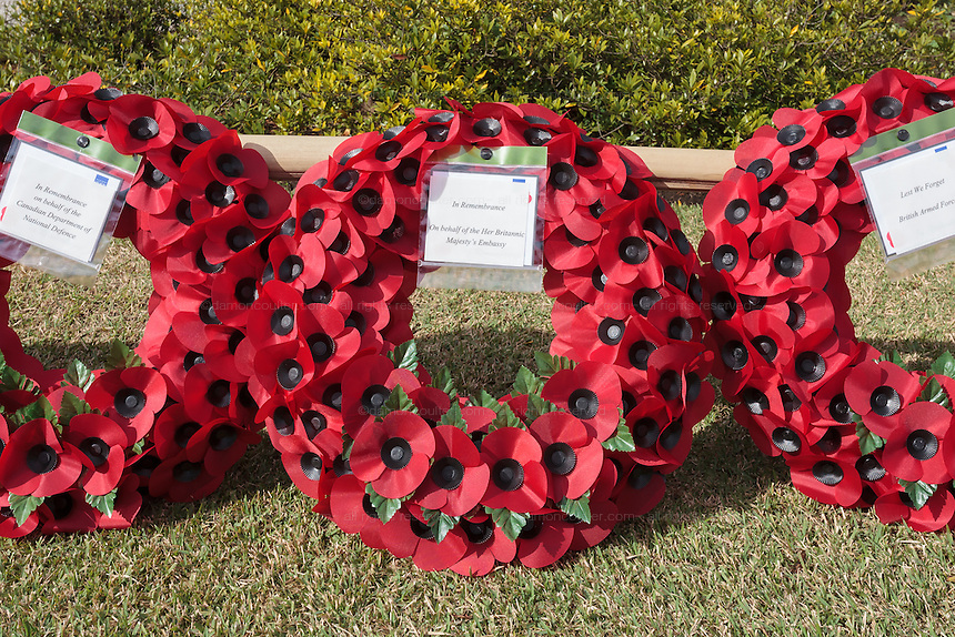 Wreaths of poppies from the British Embassy in Tokyo, The British Armed Forces and The Canadian Department of Defence laid during the Remembrance Day ceremonies at the Commonwealth War Cemetery in Hodogaya, Yokohama, Japan. Wednesday November 11th 2015