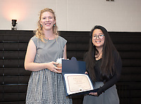 Isabella McShane '19, recipient of the Lucille Y. Gilman Memorial Award. Chloe Zeller '19 presents.<br /> Graduating seniors, faculty and staff enjoy Class Day and Senior Brunch in Rush Gym, Friday, May 17, 2019.<br /> (Photo by Marc Campos, Occidental College Photographer)