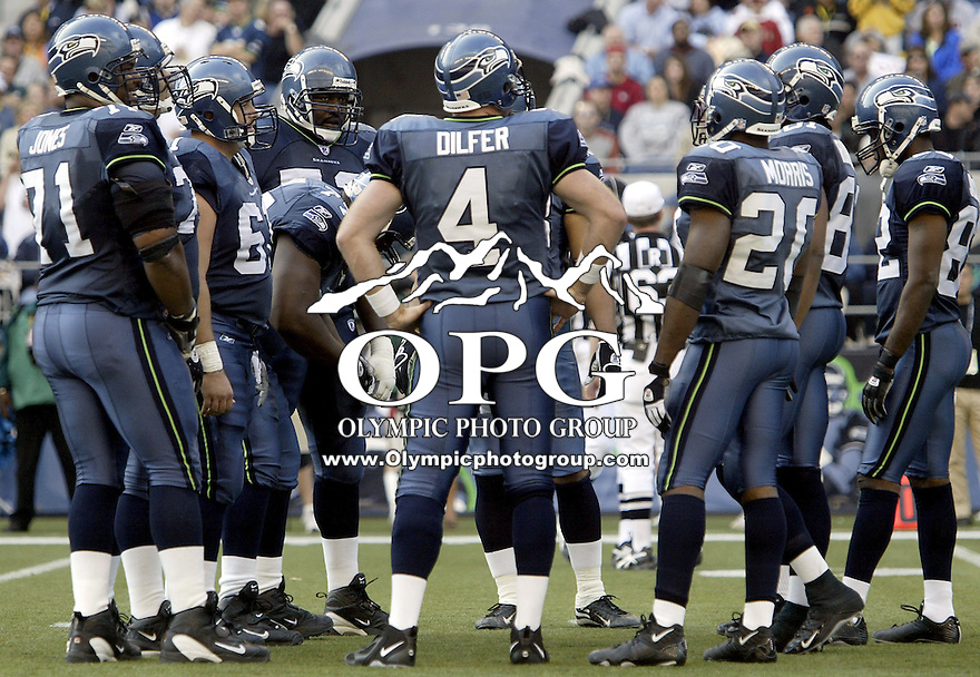 Seattle Seahawks quarterback Trent Dilfer calls out the play in the huddle at Quest Field in Seattle, WA.