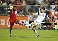 13 August 2011: Toronto FC defender Danleigh Borman #25 and Real Salt Lake midfielder Will Johnson #8 in action during a game between Real Salt Lake and Toronto FC at BMO Field in Toronto..Toronto FC won 1-0.