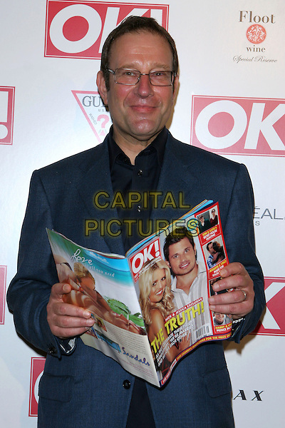 RICHARD DESMOND (PUBLISHER OF OK! MAGAZINE).OK! Magazine U.S. Debut Party held at LAX, Hollywood  CA..October 25th, 2005.Photo credit: Jacqui Wong/AdMedia/Capital Pictures.Ref: JW/ADM.half length reading Nick & Jessica.www.capitalpictures.com.sales@capitalpictures.com.© Capital Pictures.