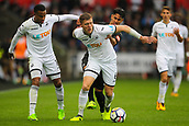 10th September 2017, Liberty Stadium, Swansea, Wales; EPL Premier League football, Swansea versus Newcastle United; Alfie Mawson of Swansea City  holds off the challenge from Ayoze Perez of Newcastle United