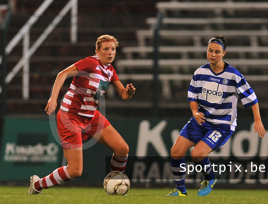 20130913 - ANTWERPEN , BELGIUM : Antwerp Sophie Mannaert (left) and Gent's Laura Van Calenberg pictured during the female soccer match between Royal Antwerp FC Vrouwen / Ladies and K AA Gent Ladies at the BOSUIL STADIUM , of the fourth matchday in the BENELEAGUE competition. Friday 13 September 2013. PHOTO DAVID CATRY