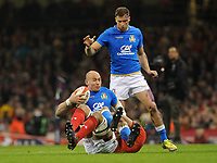 Italy&rsquo;s Sergio Parisse is tackled by Wales Taulupe Faletau<br /> <br /> Photographer Ian Cook/CameraSport<br /> <br /> 2018 NatWest Six Nations Championship - Wales v Italy - Sunday 11th March 2018 - Principality Stadium - Cardiff<br /> <br /> World Copyright &copy; 2018 CameraSport. All rights reserved. 43 Linden Ave. Countesthorpe. Leicester. England. LE8 5PG - Tel: +44 (0) 116 277 4147 - admin@camerasport.com - www.camerasport.com