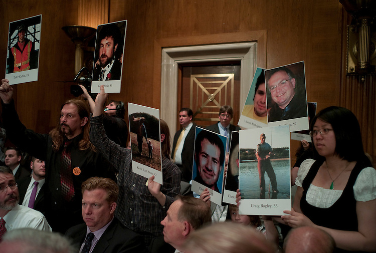 WASHINGTON, DC - April 27: At the request of Chairman Tom Harkin, D-Iowa, relatives of laborers who died in mining and other work-related accidents hold up photos of their loved ones during the Senate Health, Education, Labor and Pensions Committee hearing on mine safety, and safety in other workplaces, in the wake of the disaster at Upper Big Branch mine in Montcoal, W.Va., that killed 29 workers this month. Saying that no one should die for a paycheck, the new head of the Mine Safety and Health Administration asked lawmakers Tuesday for additional authority to go after scofflaw mine owners, even as he vowed tougher enforcement under existing law. (Photo by Scott J. Ferrell/Congressional Quarterly)
