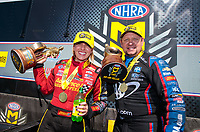 Apr 14, 2019; Baytown, TX, USA; NHRA top fuel driver Brittany Force (left) celebrates with funny car teammate Robert Hight after winning the Springnationals at Houston Raceway Park. Mandatory Credit: Mark J. Rebilas-USA TODAY Sports
