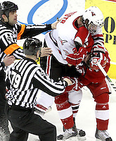 UNO's Andrej Sustr and Wisconsin's Craig Smith grapple during Friday's game. UNO beat Wisconsin 4-1 Friday night at Qwest Center Omaha.  (Photo by Michelle Bishop)