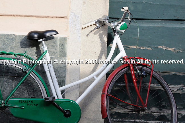 "Red, green and white bike in Menaggio (town on Lake Como, Italy) that has ""Italian Dream"" written on it."